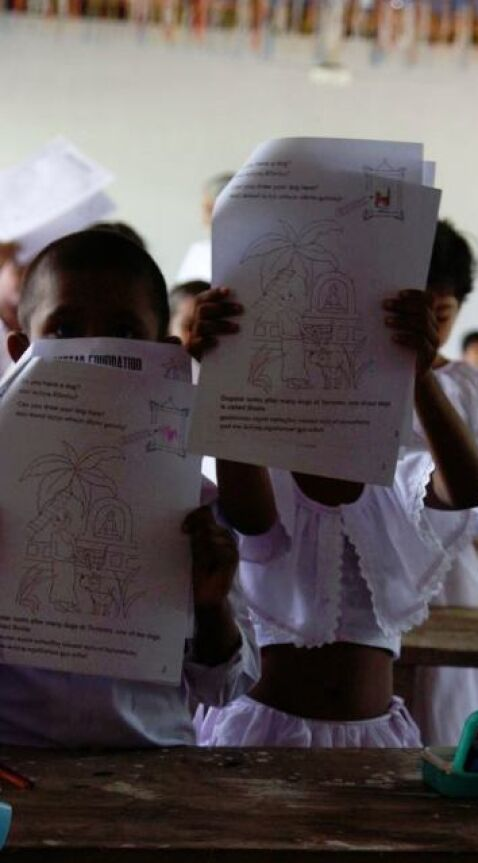 children showing their completed work Sri Lanka
