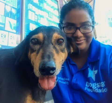Dogstar dog Fred and team member Anjali.