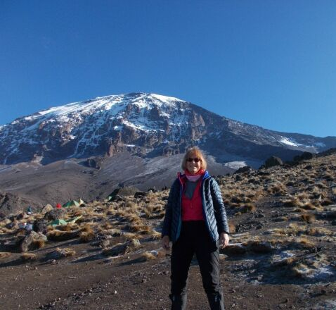 Ros stands in front of Kilimanjaro