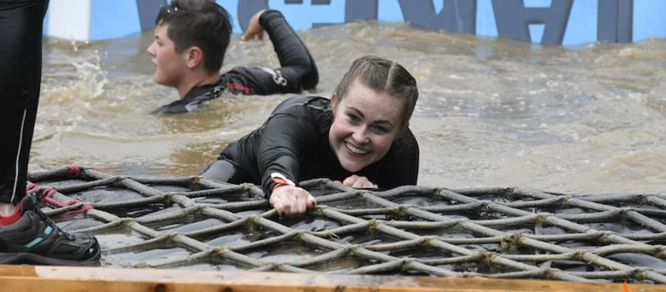 hannah tough mudder in the water for dogstar foundation